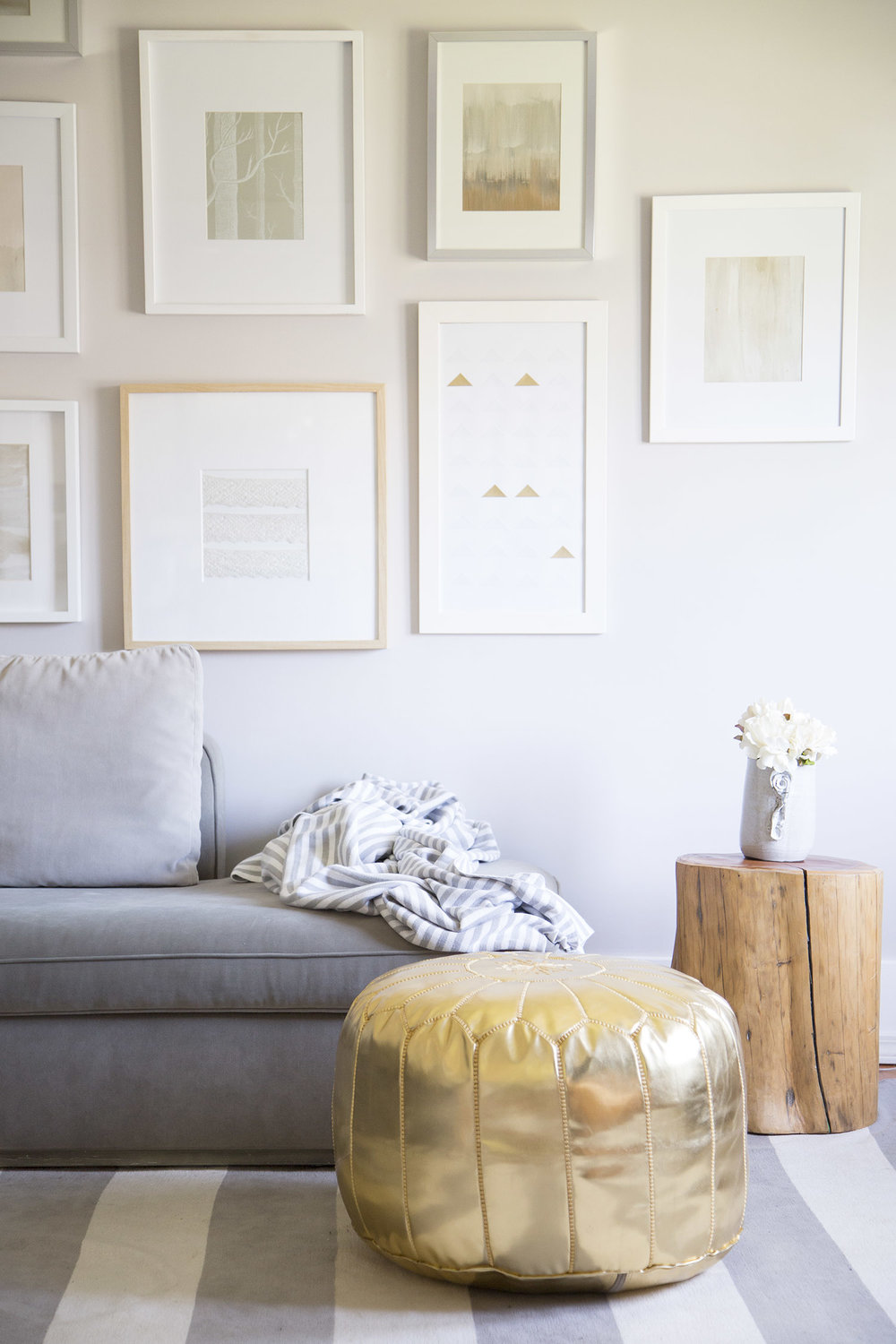 living room with gold pouf