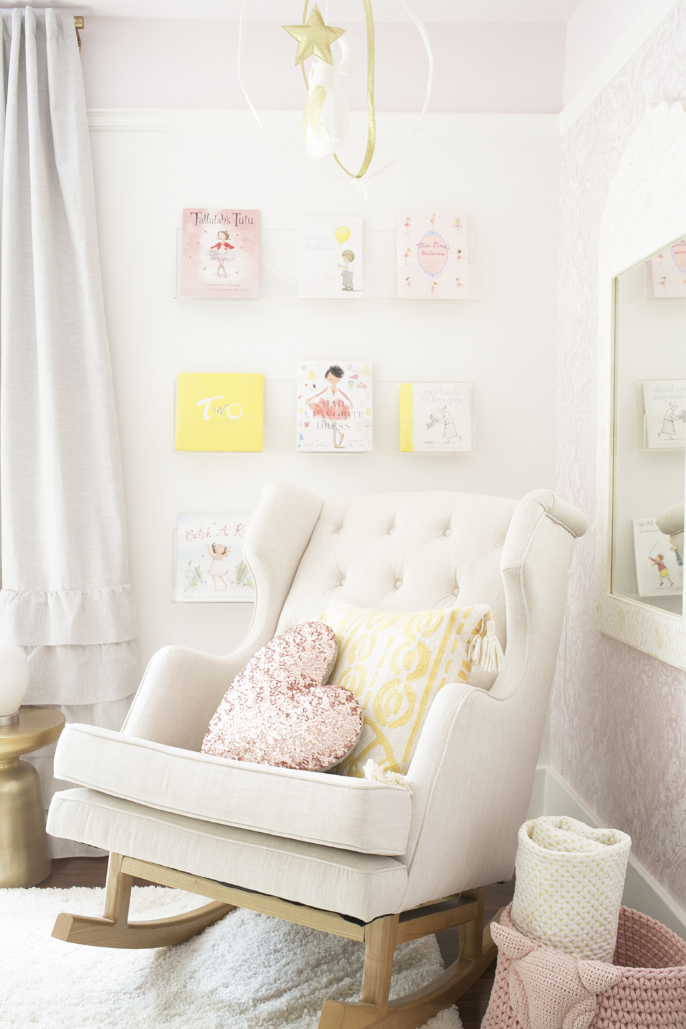 Ubabub book wall in baby girl nursery