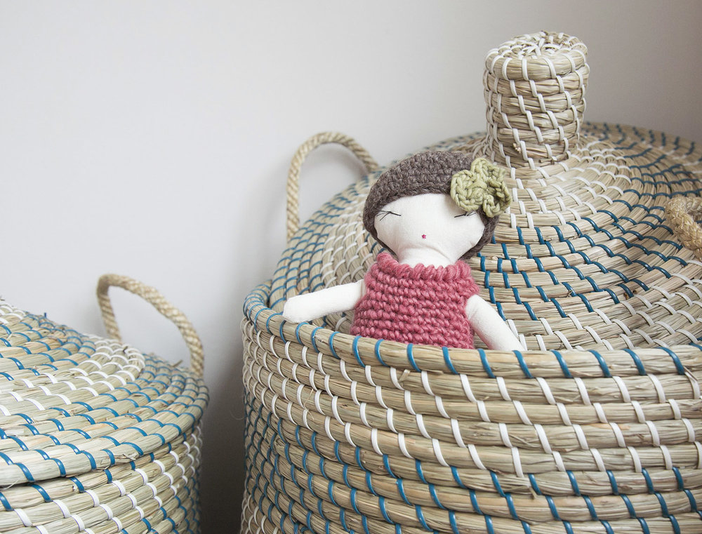 handmade doll in basket