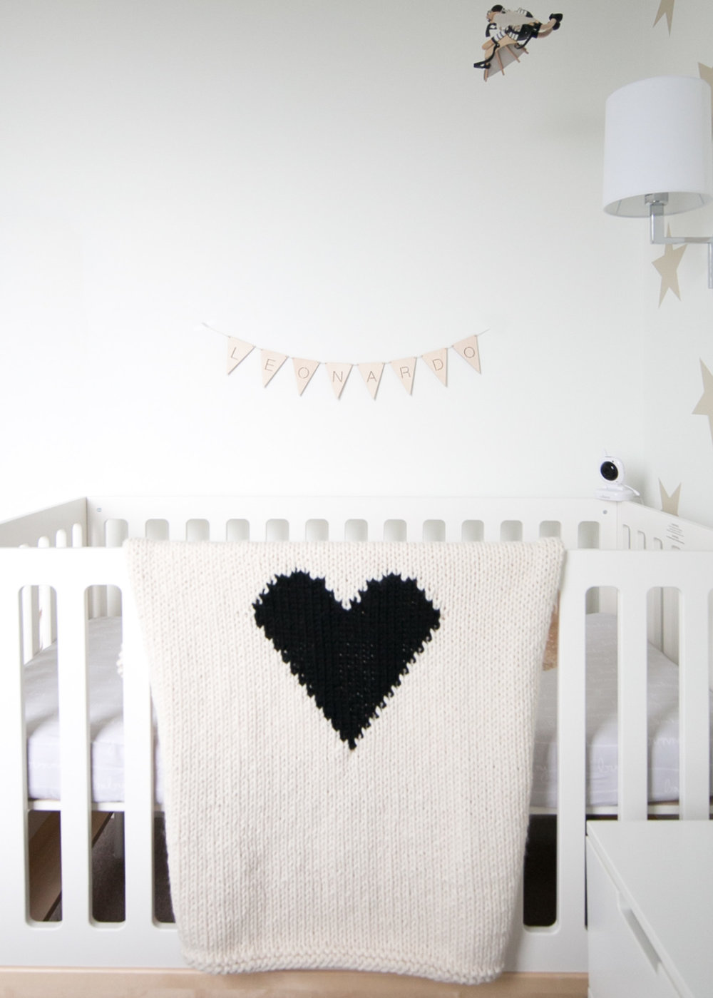 Yarning made heart blanket in Vancouver baby nursery