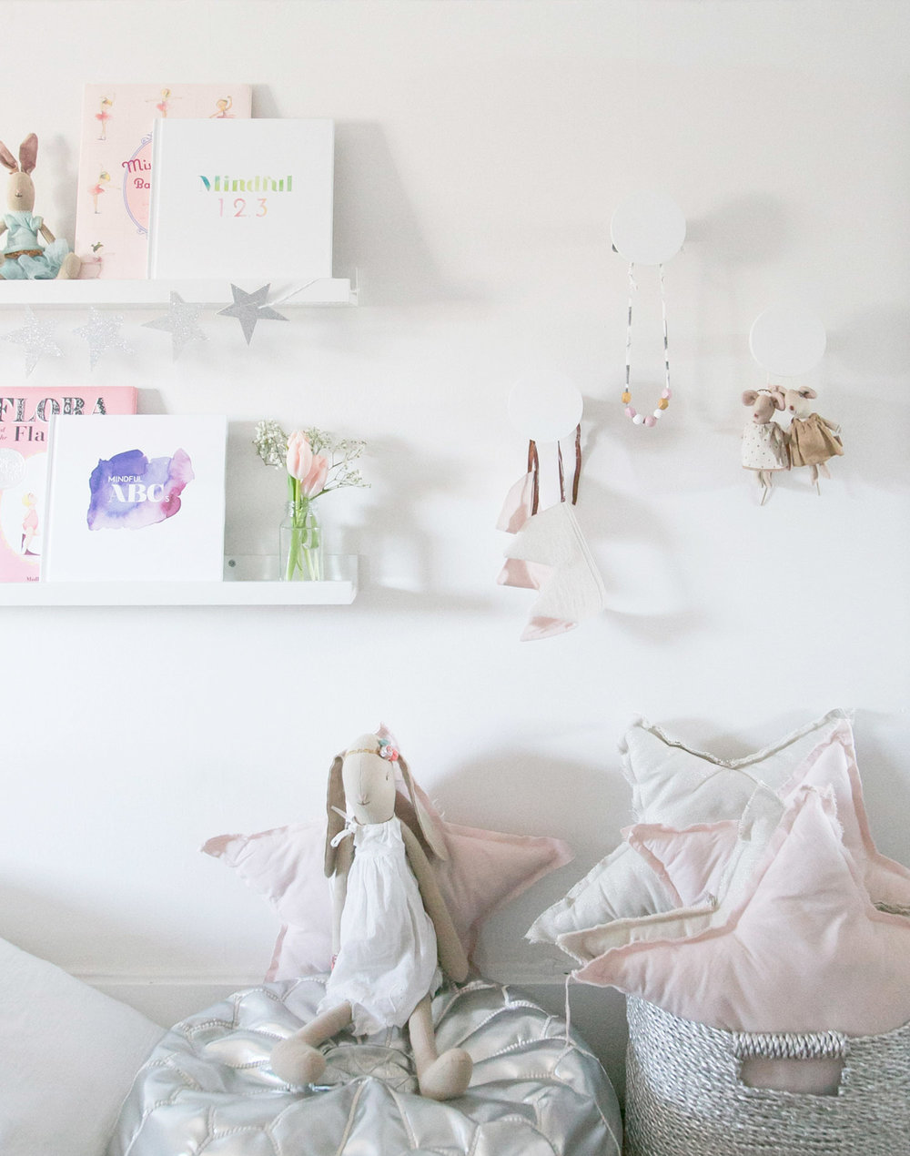 bookshelves and wall hooks in girls room