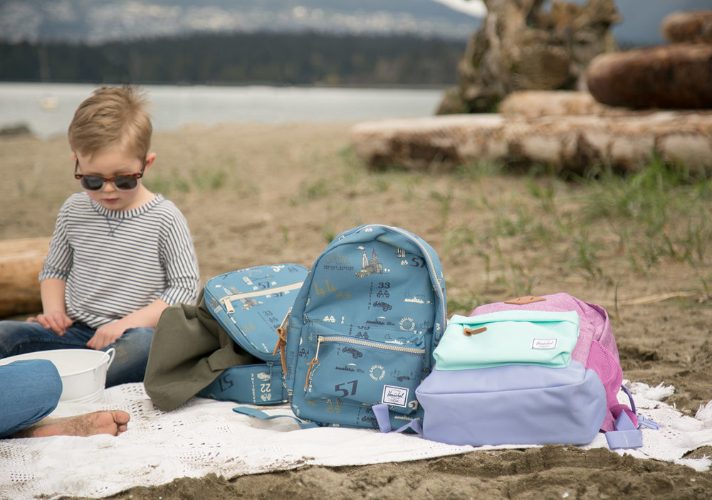 Hershel Supply Kids Collection backpacks on beach