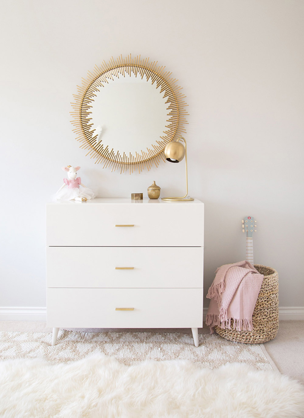 white mid century modern dresser in girls room