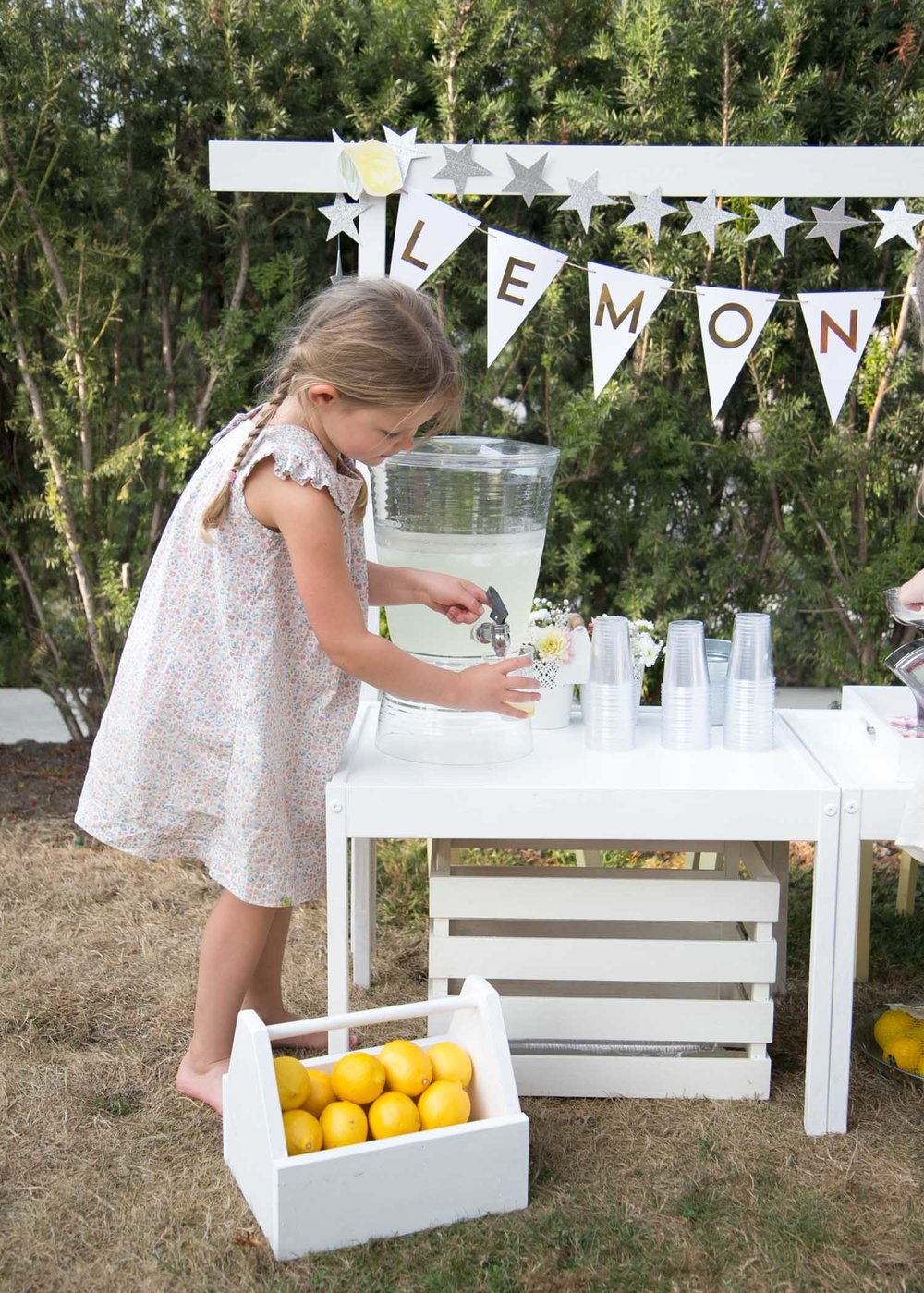Noelle filling up lemonade