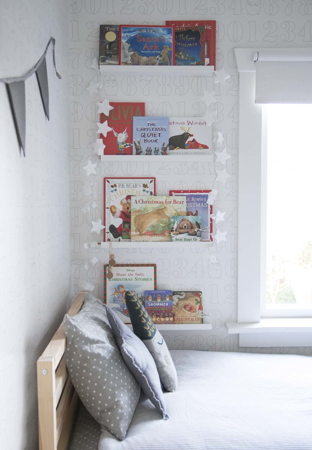 Kids room with Christmas books on shelf