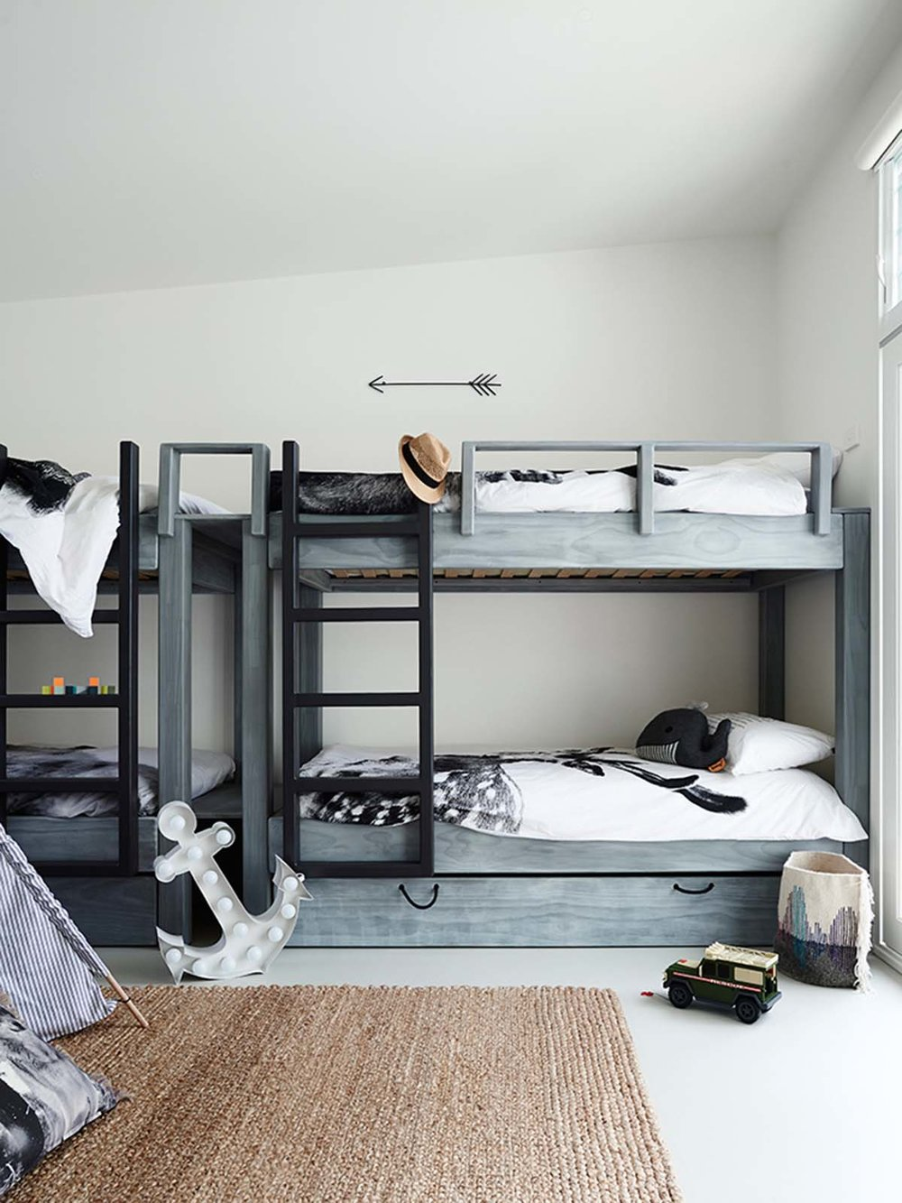 grey bunk beds in shared boys room
