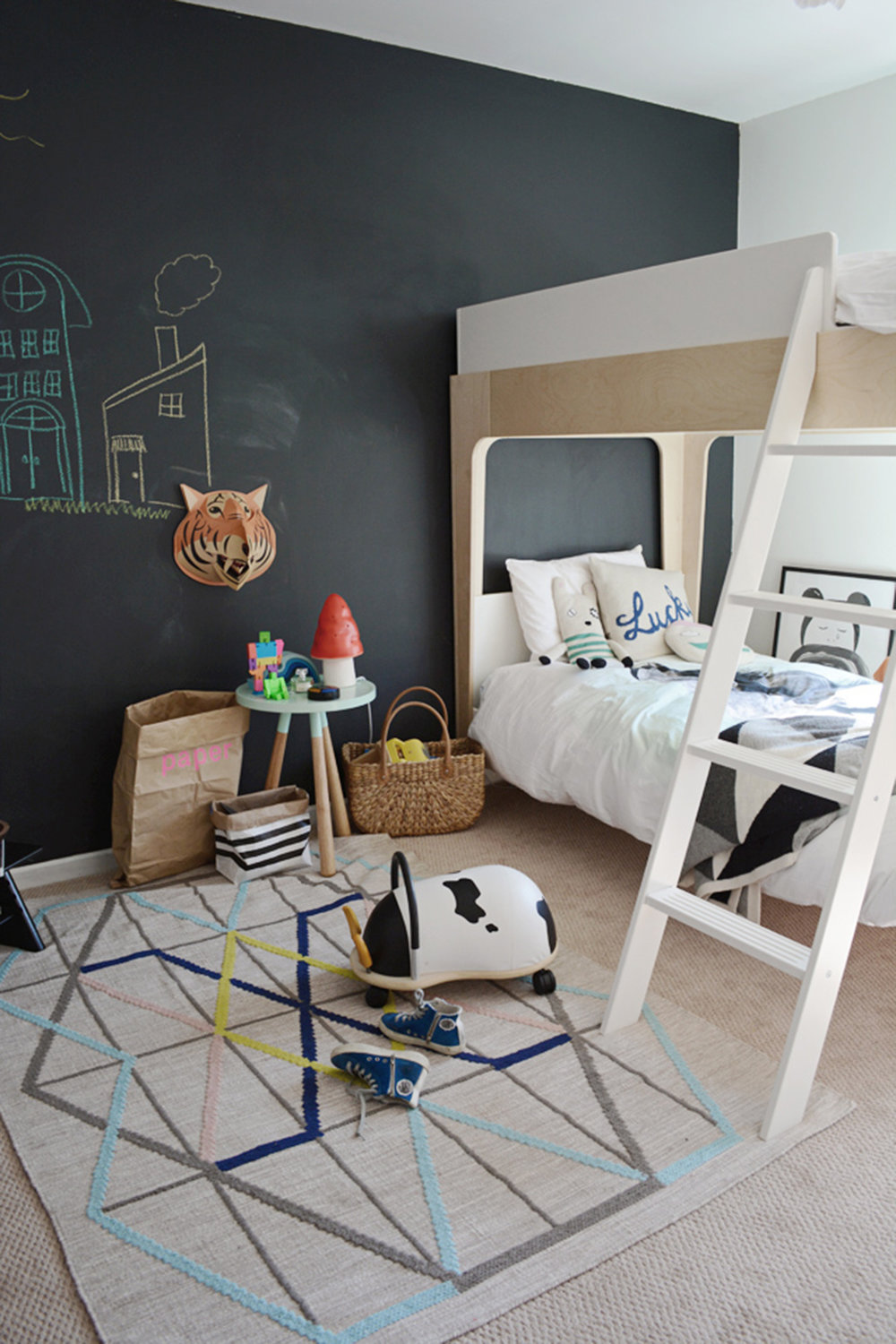oeuf bunk bed in kids room with chalkboard wall