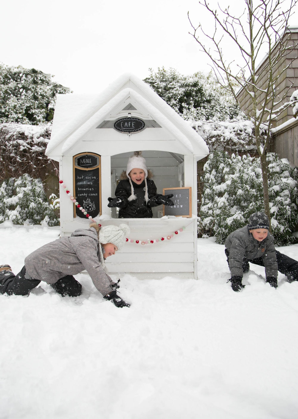 Kids playhouse in winter with snow