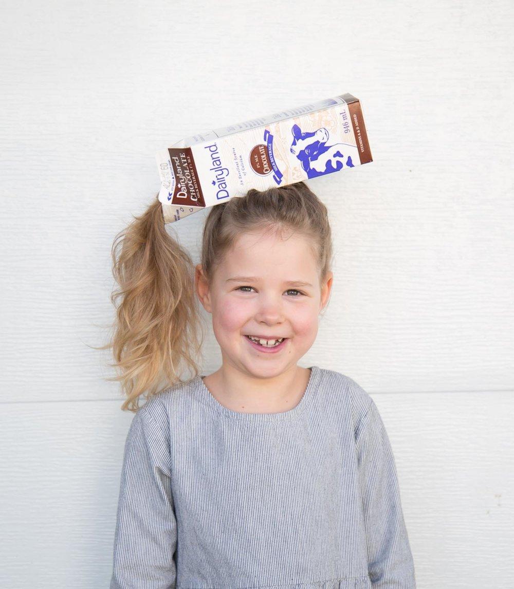 kids crazy hair day chocolate milk carton on head