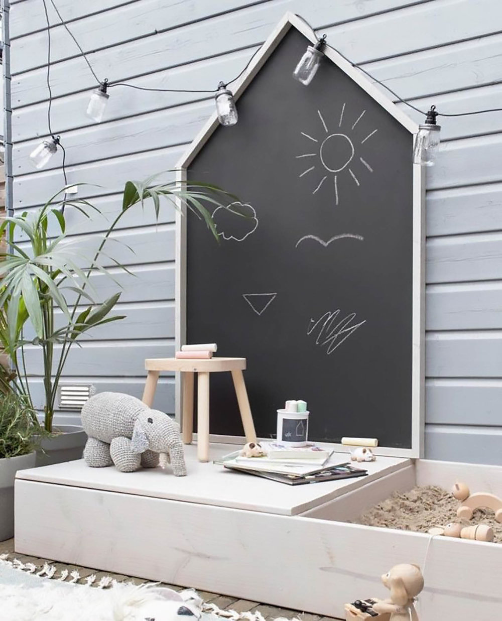 modern house shaped outdoor chalkboard and sandpit for kids