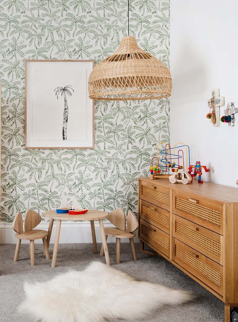 palm wallpaper with rattan pendant in boys room
