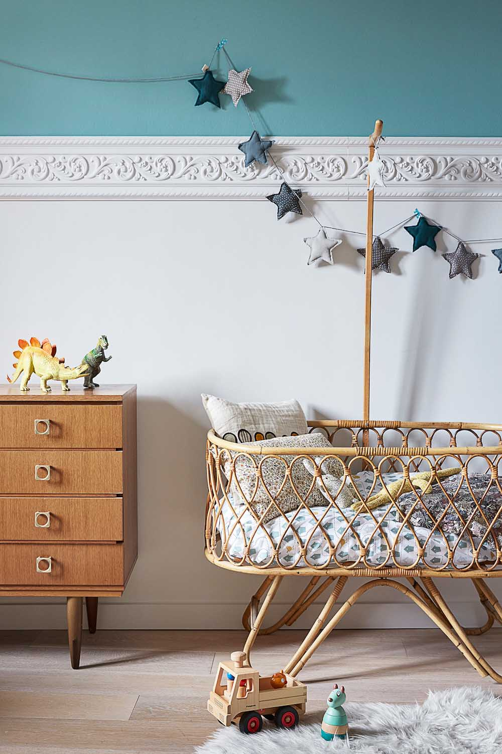 vintage bassinet in baby nursery