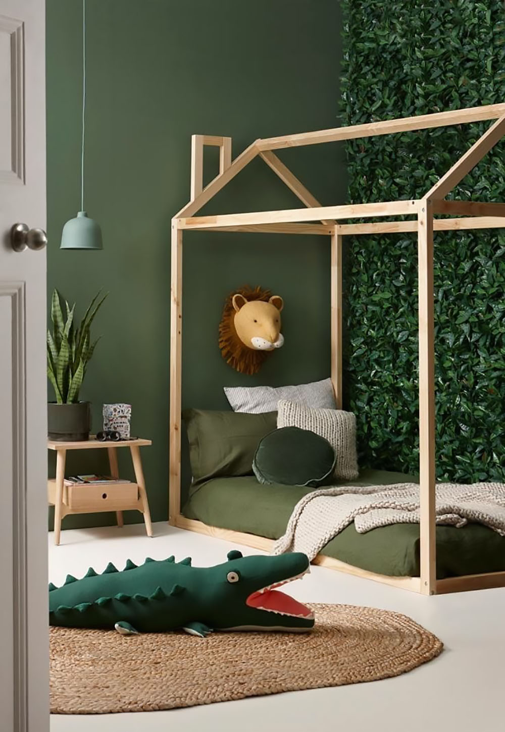 house bed frame in green boy room
