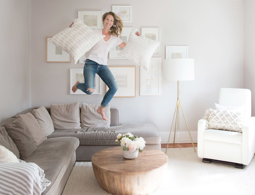 Vancouver Interior Designer and Blogger Melissa Barling jumping on couch in living room