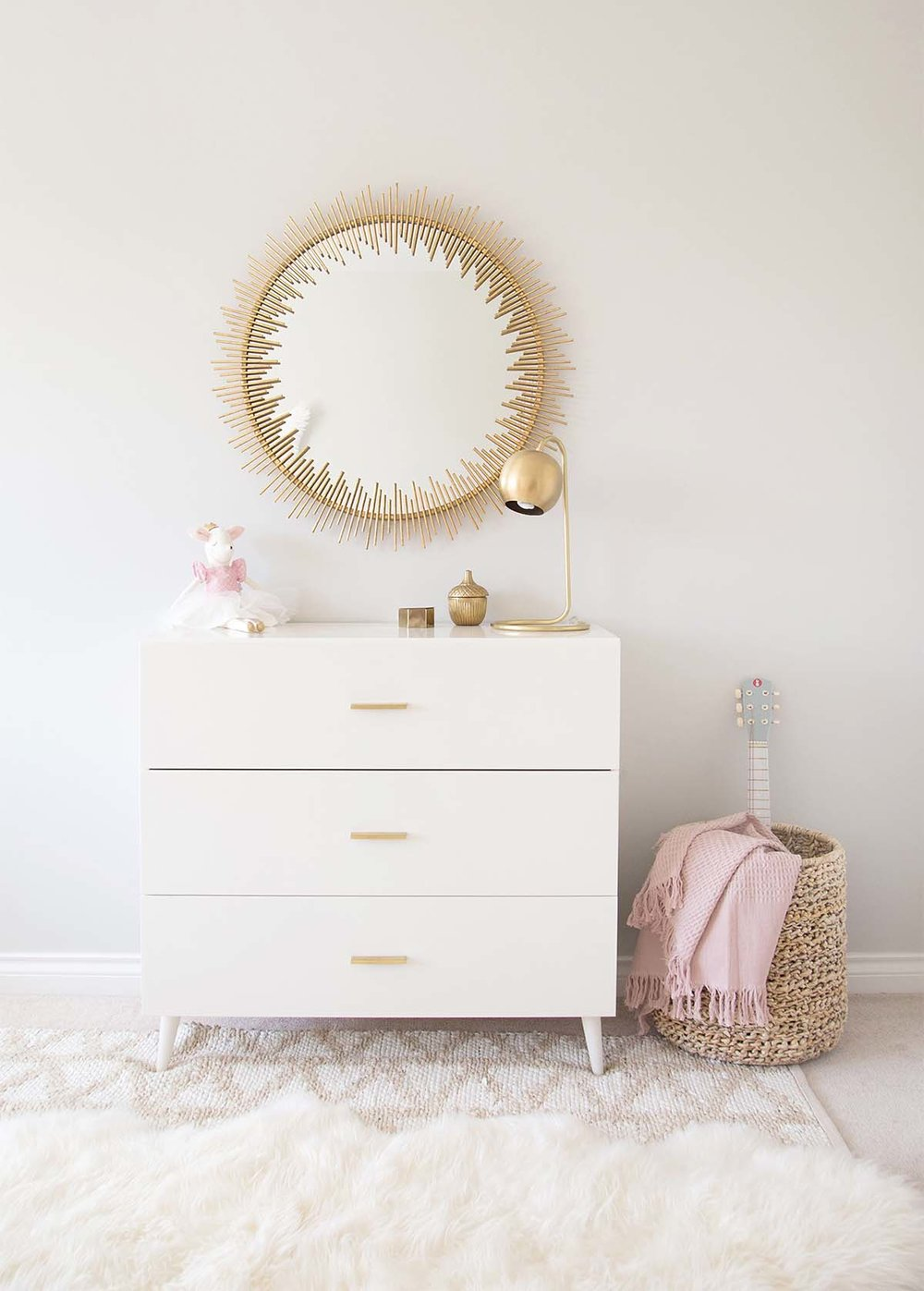 Girls room dresser with storage basket