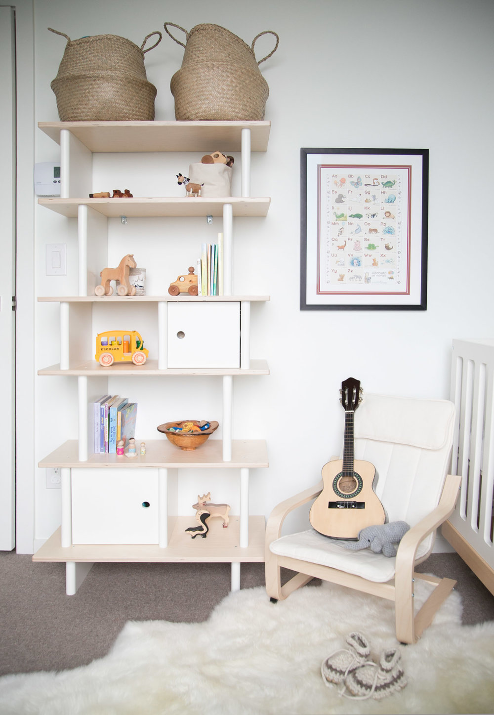storage shelf with toys in kids room