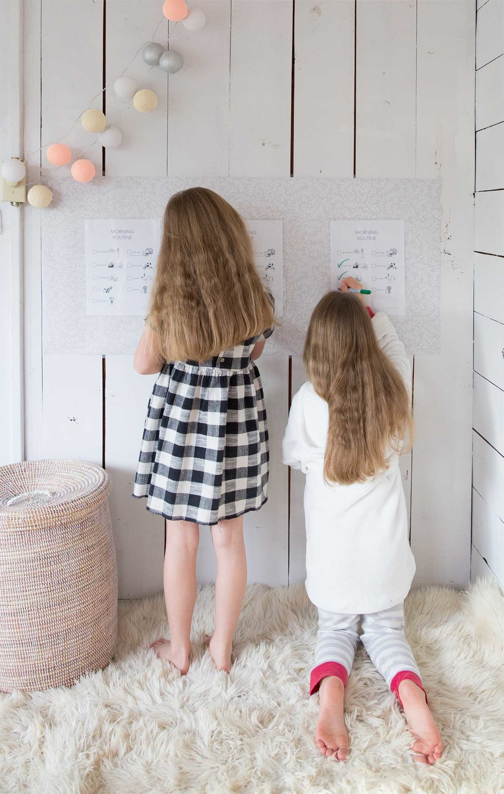 girls completing morning routine chart