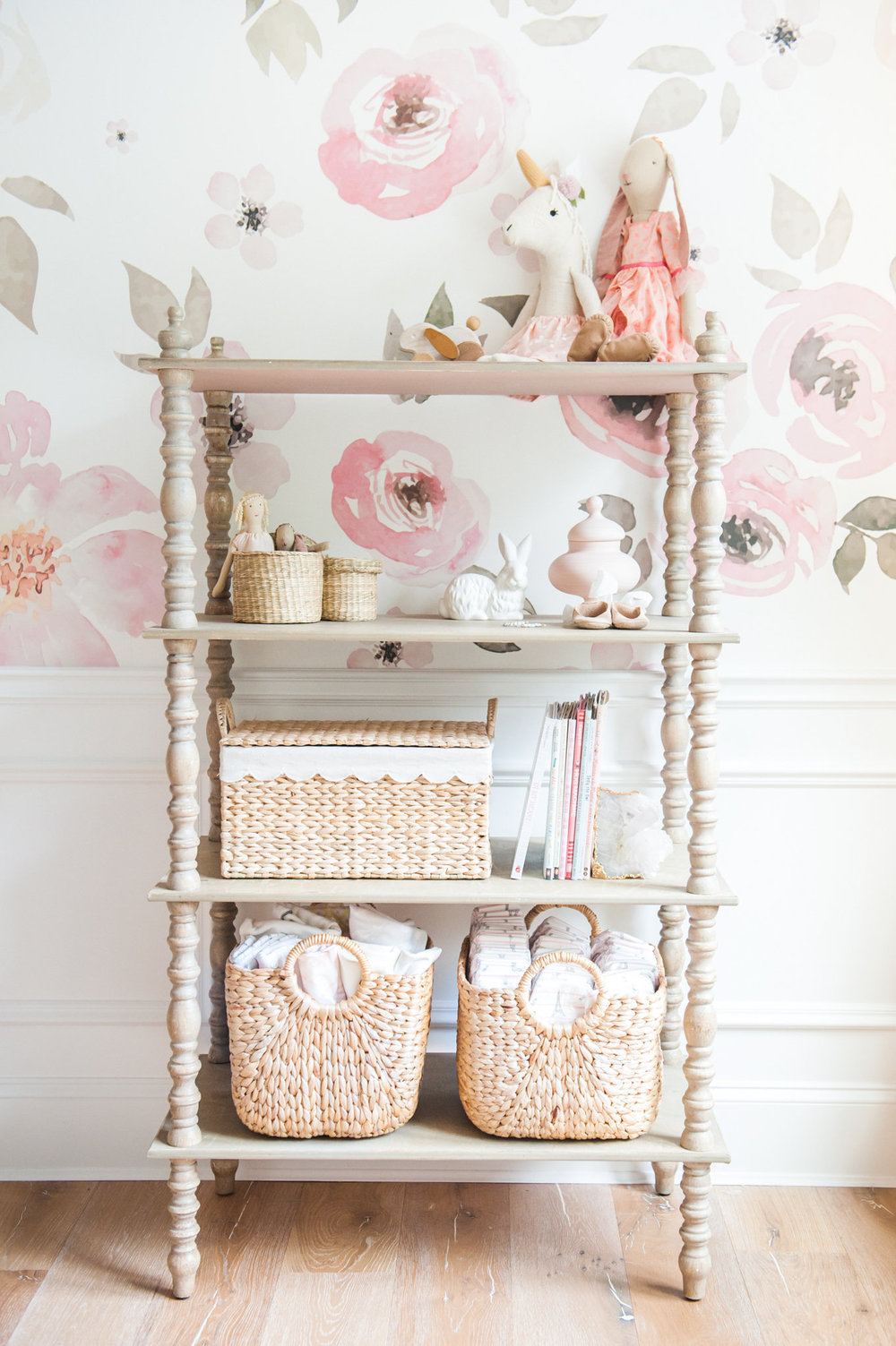 Floral wallpaper in baby girl nursery