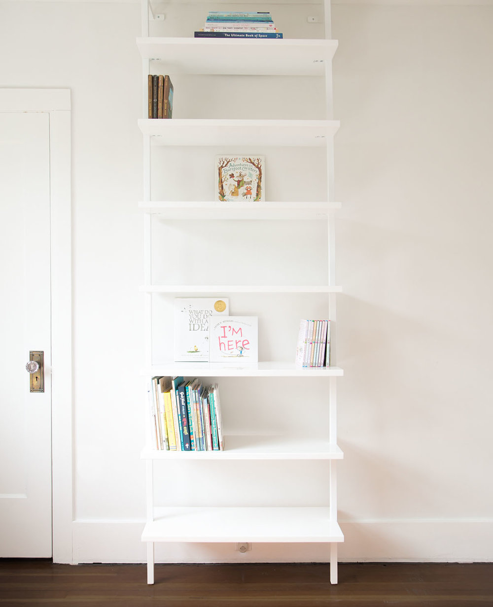 cb2 stairway bookshelf with books - this is step 2