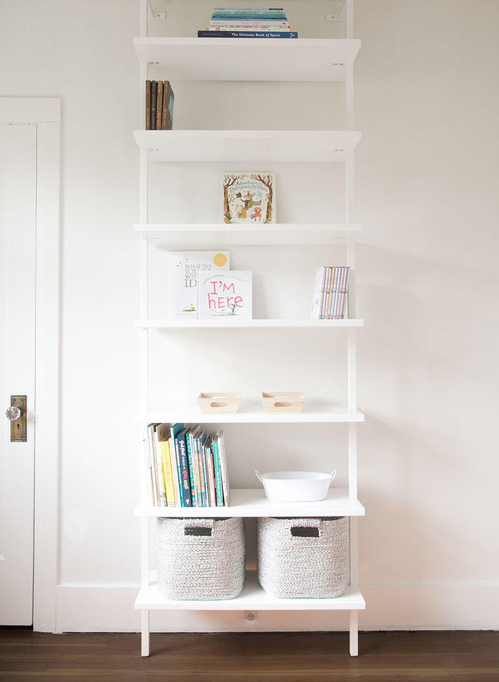 cb2 stairway white shelf with books and baskets - this is step 3