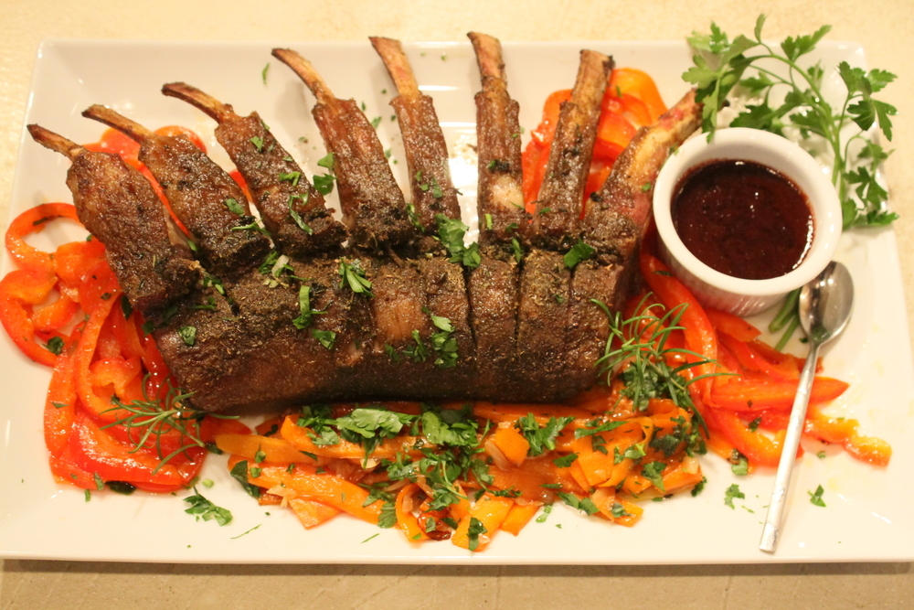 Lamb chops with cherry sauce and ribbons of carrot and red pepper