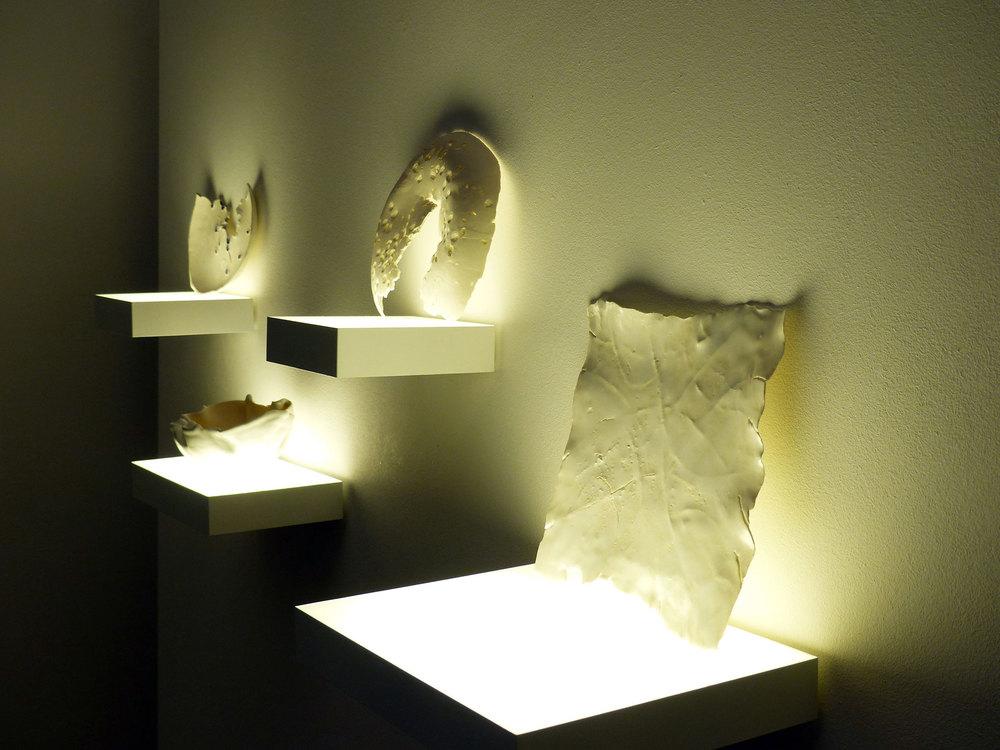 Katja v. Ruville, 2015,  vergraben | buried , porcelain, black rice, mung beans, rice noodles, pigment,   ∅   13cm, 18 cm, 22 cm | 21 x 21 cm