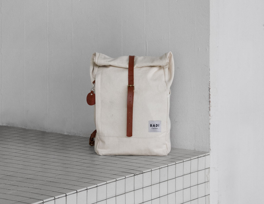 The Roll-Over backpack in natural with brown leather