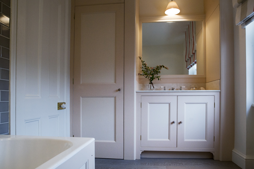 A family bathroom in warm greys and pinks
