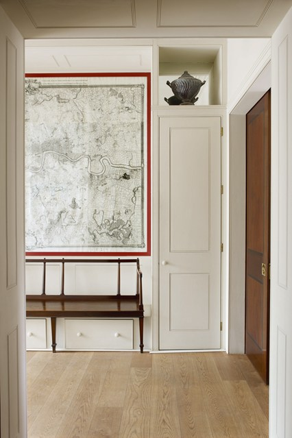 Striking use of a map set within panelling in Will Fisher's South-East London home