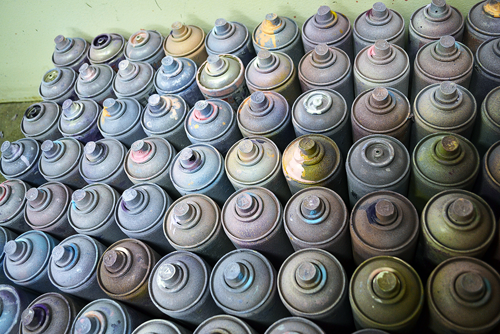 spray cans used by artist ali tareen for art project.jpg