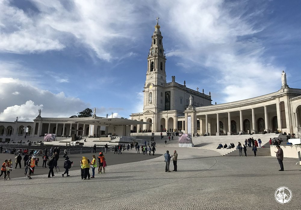 The Basilica of Fátima, flanked by stepped colonnades we would soon find shelter in.