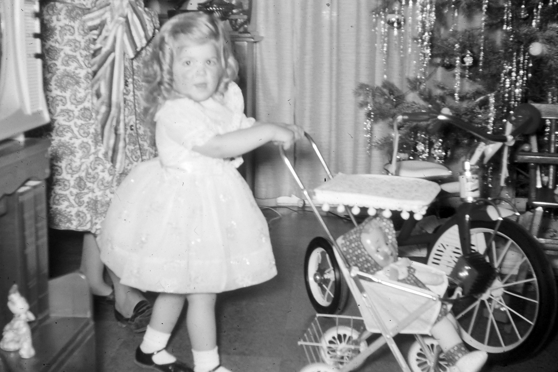 my mother and her doll on christmas day - 1950s Christmas