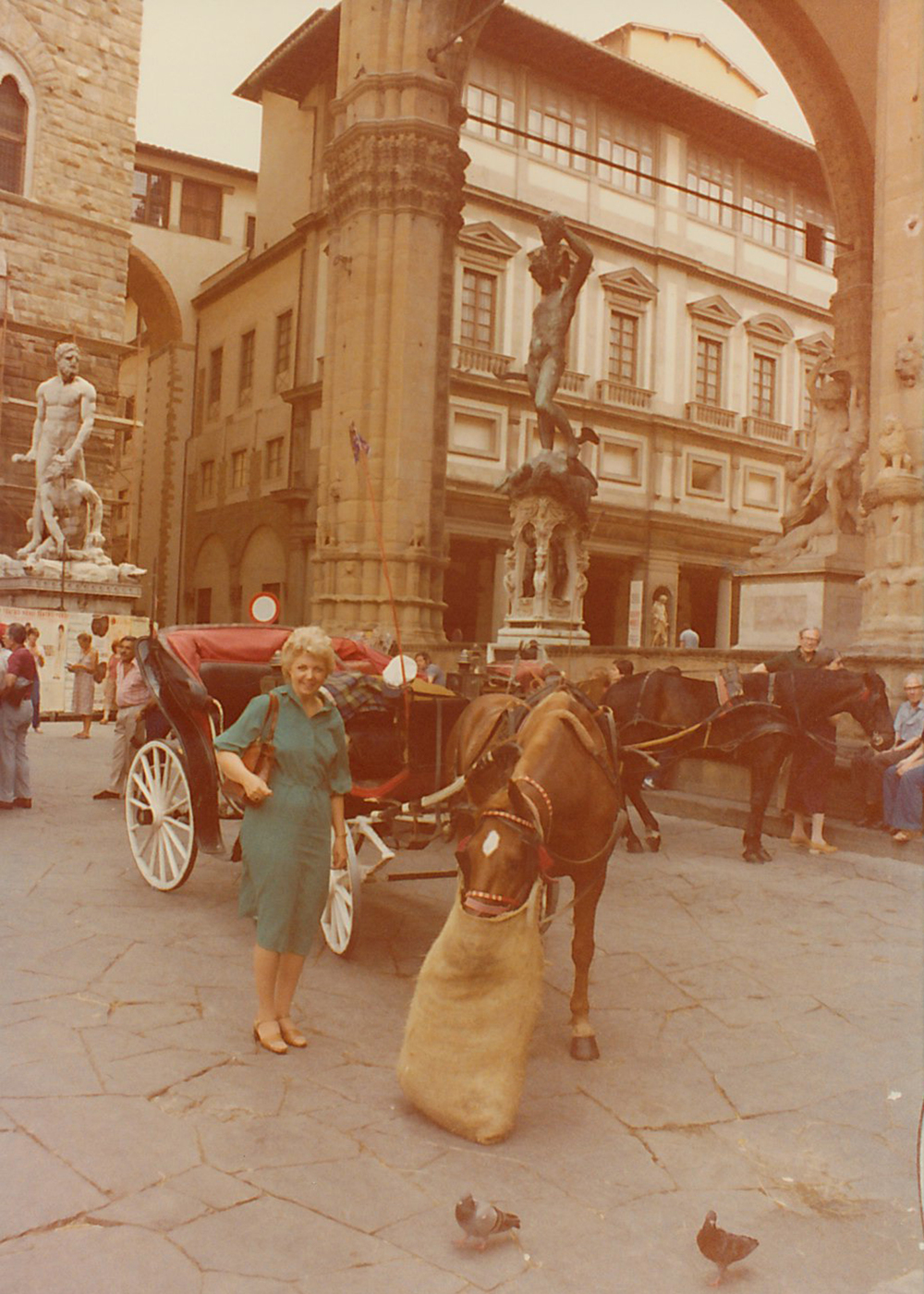 Joan with a horse and some pigeons in Rome, Italy. She loved all animals.