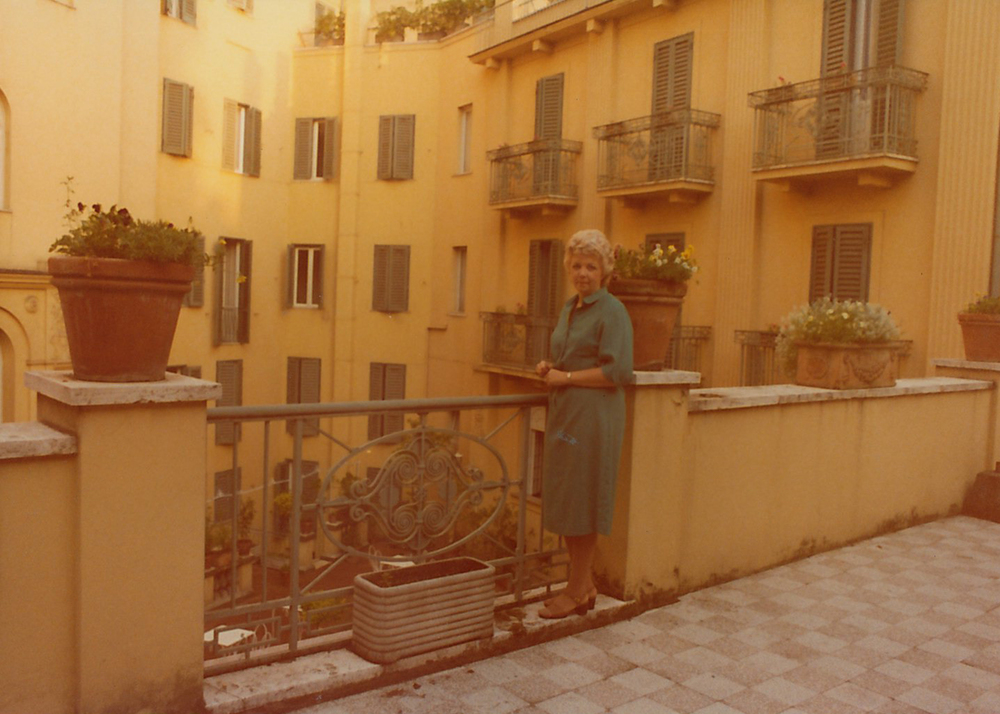 My pretty grandmother. The colors in this one are so lovely. This is Italy to me -- terra cotta pots of flowers and sun-faded buildings with terraces and shutters.