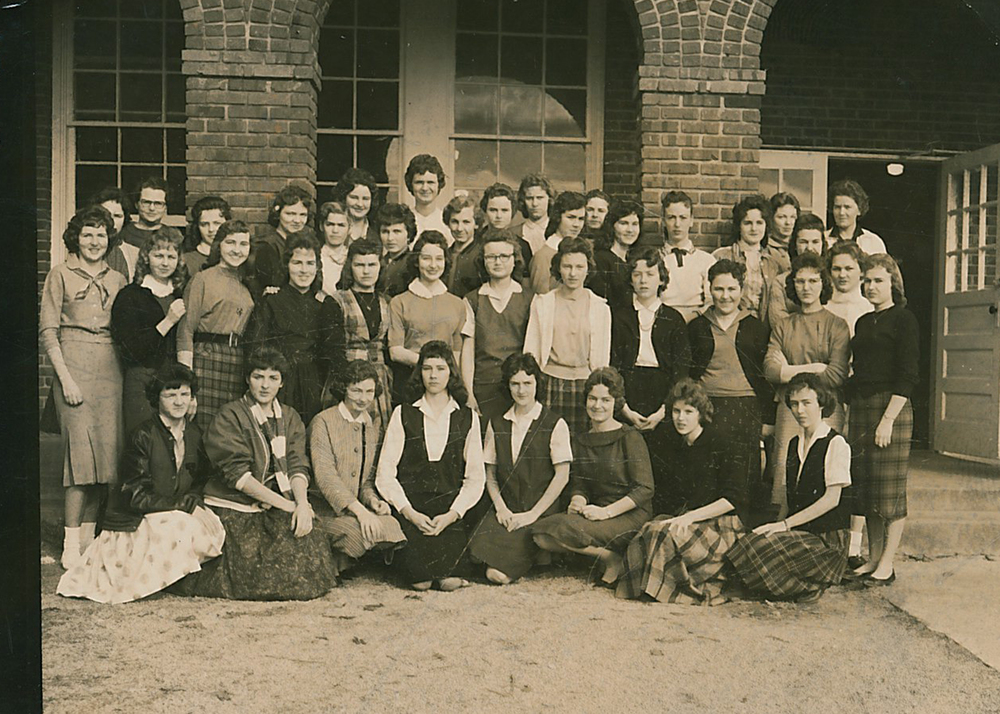 I love this yearbook photograph all of the girls in front of Jumpertown School. (The back of the photo actually has the job, page and position number on it.)