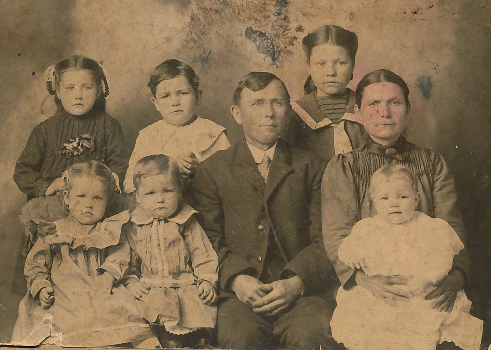 Clovis (back row, second from left) and his family.
