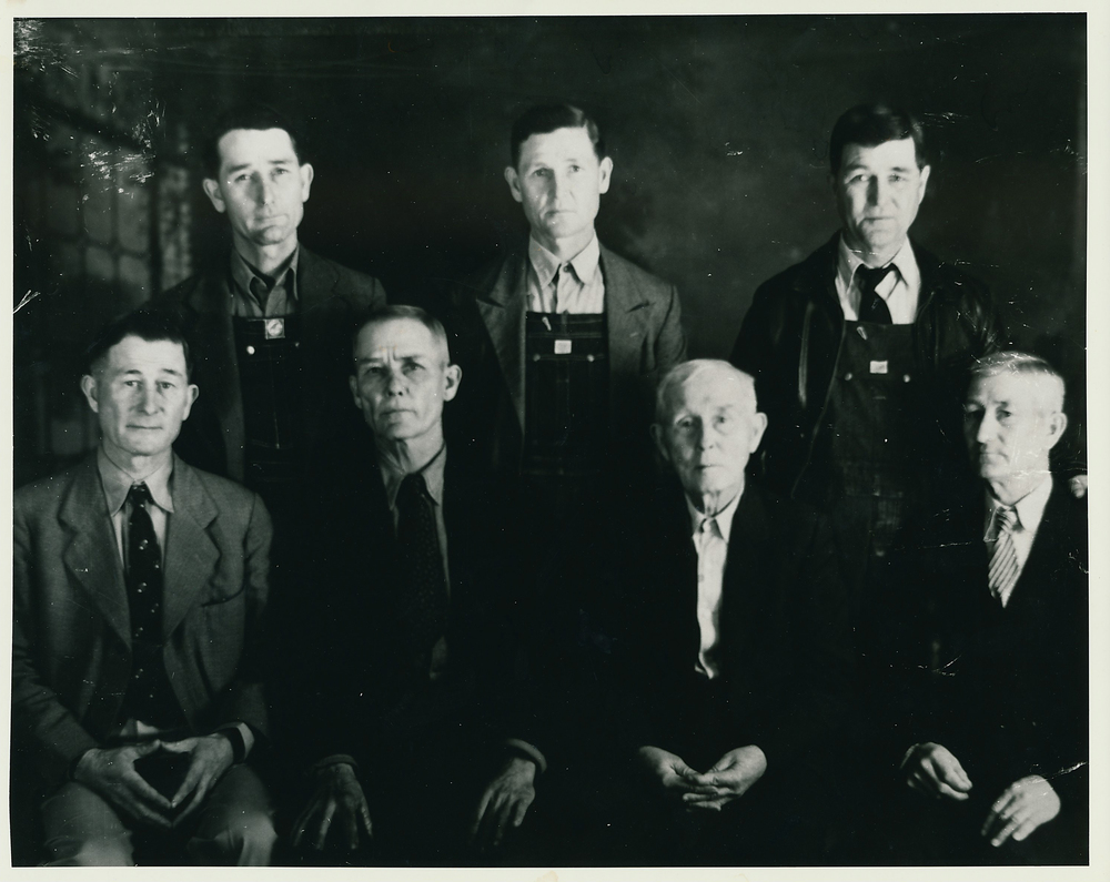 Clovis (back row left) and his family.