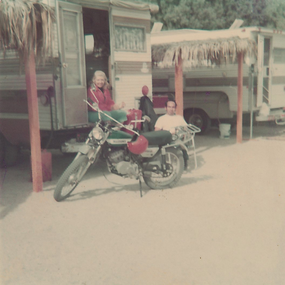 Joan, Sid, the original camper and the motorcycle.