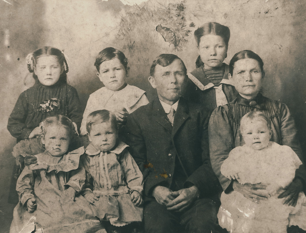 Jonathan's great-grandfather  Clovis Yates  (back, second from left) and his great-great grandparents William and Julia.