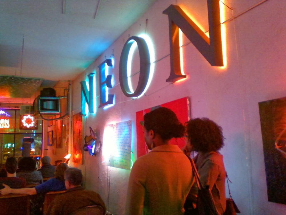 Music + Poetry + Art at the Downtown Neon Gallery