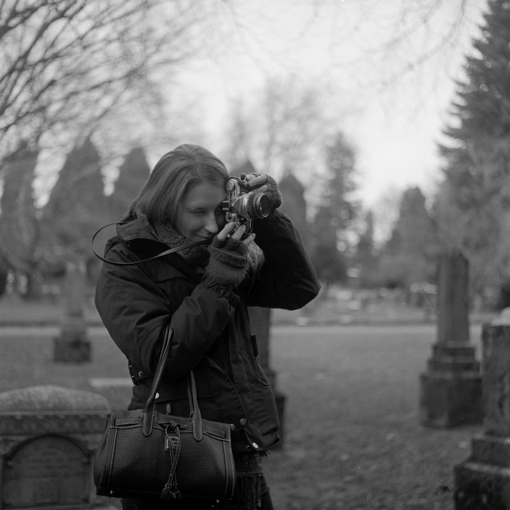 Kelsey, giving my Olympus OM-1 a test run in Lone Fir Cemetary