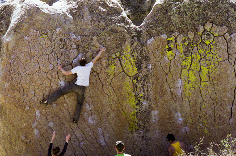 Chris balancing his way to the last jugs on Green Wall Essential, V2, the Buttermilks.  This wall has beautiful, albeit slick, patina and a lovely green lichen.