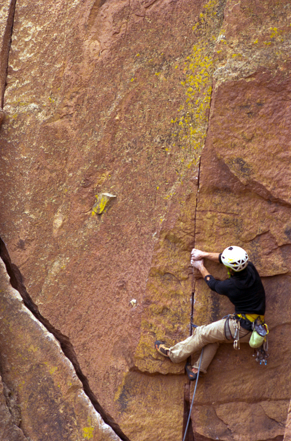 A climber displaying some great finger crack skills at Smith Rock.