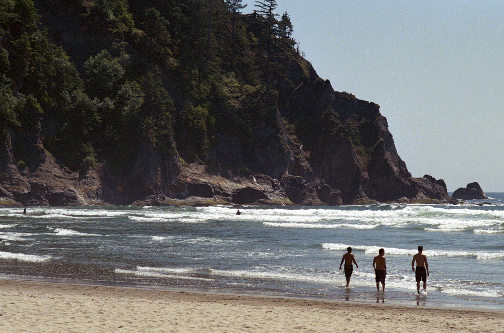 Brave (or foolish?) swimmers heading, shirtless, into the frosty waters of Oregon's rugged coast.