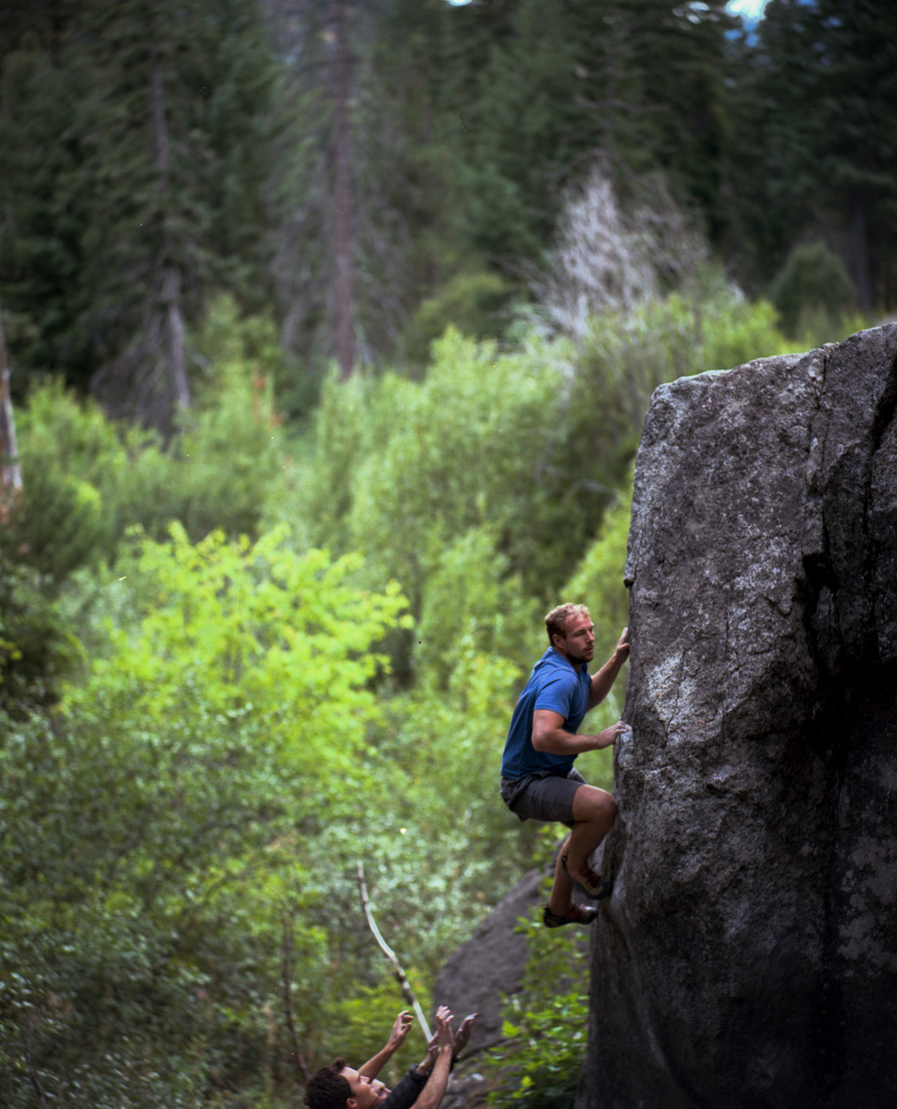 Kevin nearing the topout of Sunshine Daydream, V4 at the Egg Rock boulders, Leavenworth, WA