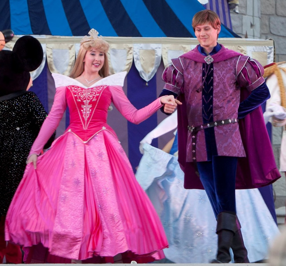 Aurora (Sleeping Beauty) and Prince Phillip in the Dream along with Mickey show it the Magic Kingdom at the Walt Disney World Resort.