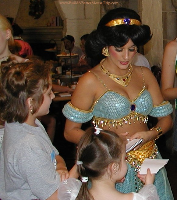 Princess Jasmine signs autographs at Disney World.