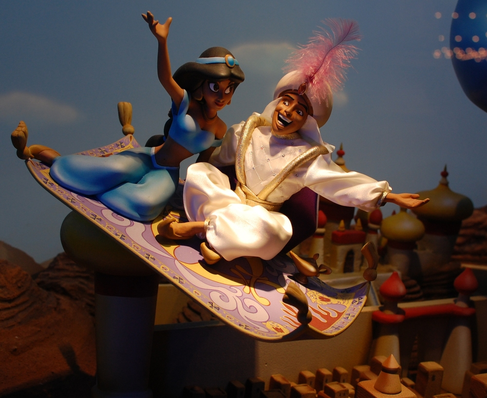 Aladdin and Jasmine in the window of the Emporium on Main Street USA at the Magic Kingdom - Disney World.