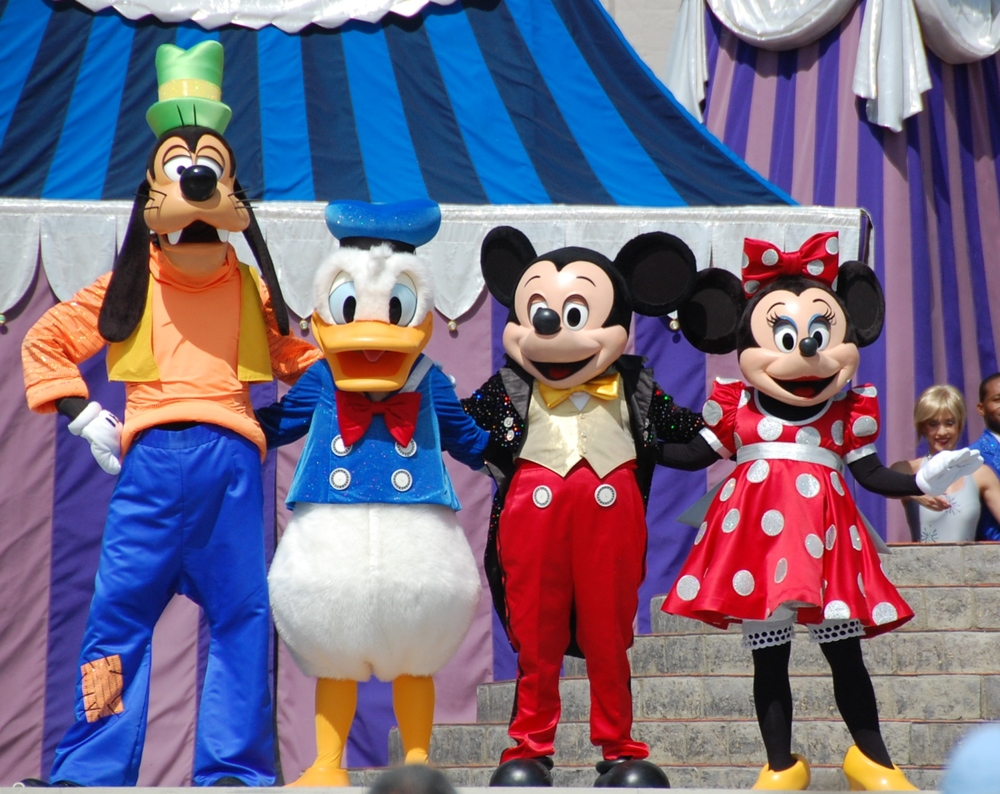 Tips for Finding Your Favorite Disney Characters at the Walt Disney World Resort in Florida - Goofy, Donald Ducky, Mickey Mouse and Minnie Mouse in Dream Along with Mickey in the Magic Kingdom at Disney World.