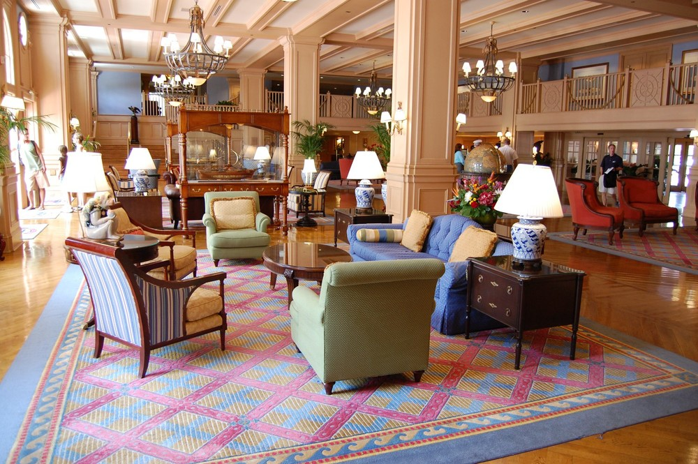Enjoy some people watching in the lobby at Disney's Yacht Club at the Walt Disney World Resort.